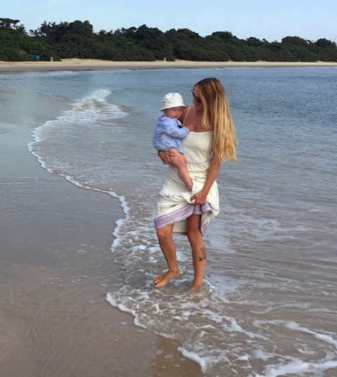 Tahnee Knowles with baby on beach